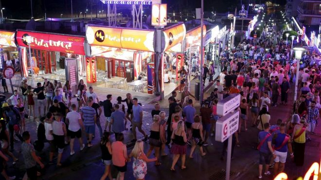 Tourists walk at Punta Ballena street in Magaluf, on the Spanish Balearic island of Majorca, 13 June, 2015.