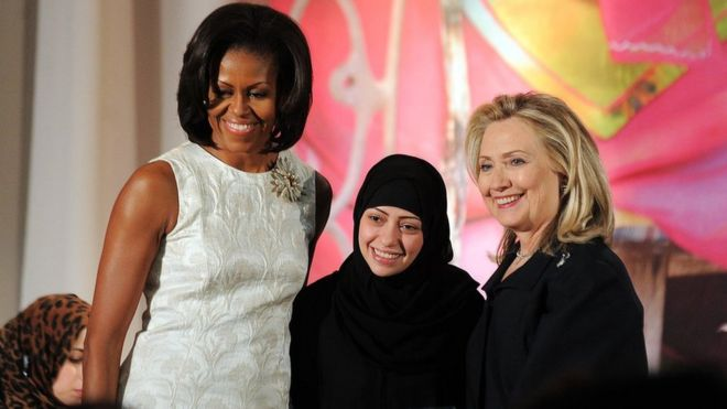 US First Lady Michelle Obama (L) and Secretary of State Hillary Clinton pose with Samar Badawi of Saudi Arabia as she receives the 2012 International Women of Courage Award during a ceremony at the US State Department in Washington DC