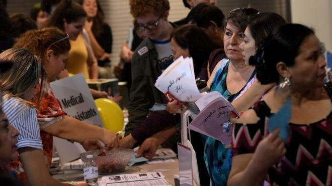 Refugees receive health advice at a free event in Glendale, California in 2017