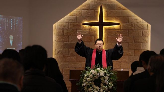 Wang Yi preaching at Early Rain Covenant Church