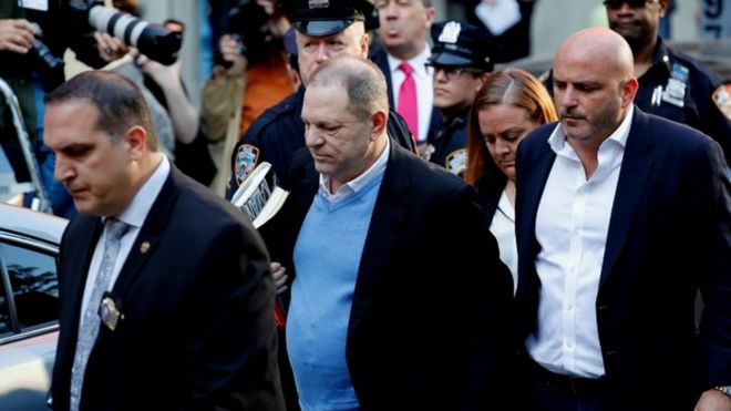 Harvey Weinstein arrives at the police station in New York