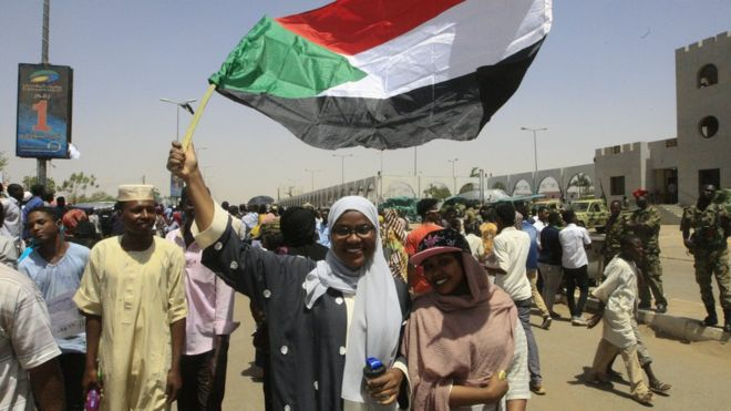 Demonstrators in Khartoum near the military headquarters, 13 April 2019