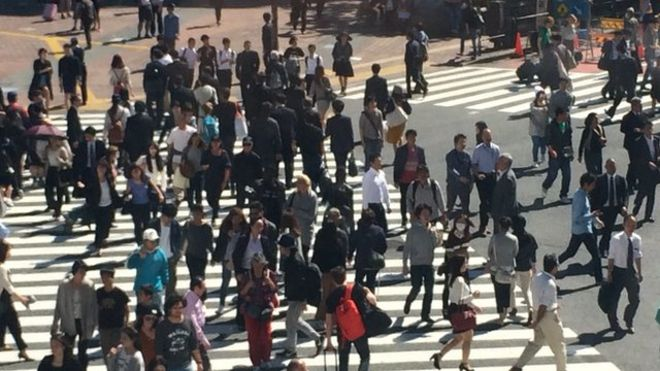 Tokyo street crossing with many people walking