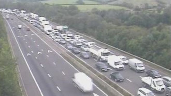 Police vehicle and car in crash on M5 northbound - BBC News