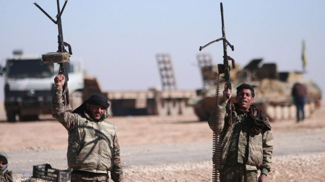 File photo showing Syrian Democratic Forces (SDF) fighters holding up their weapons north of Raqqa, Syria (3 February 2017)