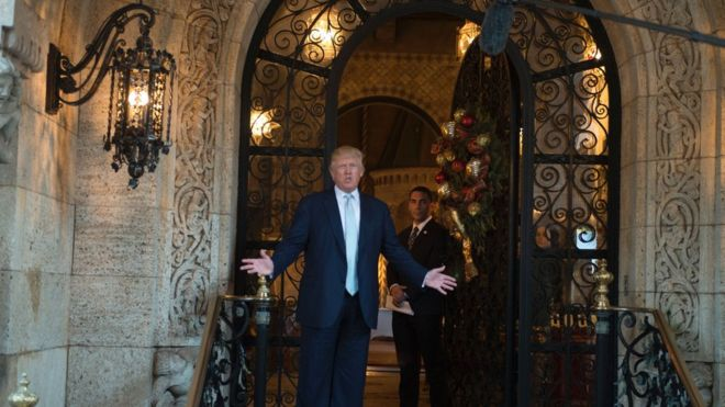Trump - standing in front of his Mar-a-Lago estate