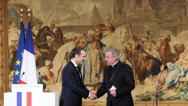 Luigi Ventura shaking hands with Emmanuel Macron