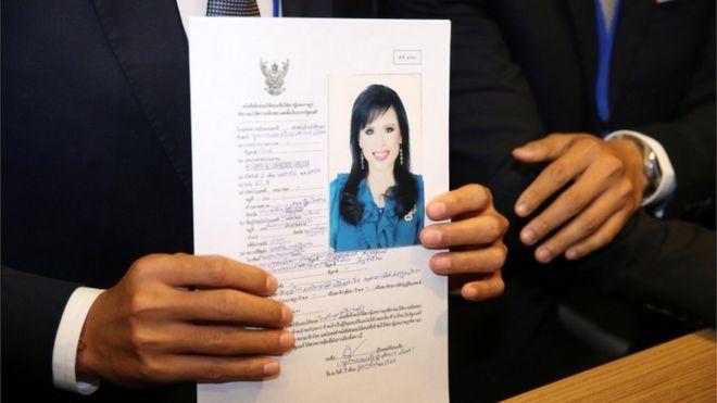 Thai Raksa Chart party leader Preechapol Pongpanich, holds up application of candidate for Prime Minister, Thailand's Princess Ubolratana Rajakanya Sirivadhana Varnavadi,