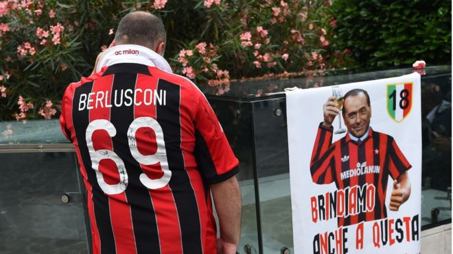 Ac bbc a supporter of the ac milan football club wears a jersey of the honorary president of voltagebd Image collections
