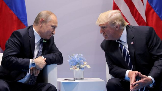 Russias President Vladimir Putin talks to US President Donald Trump during their bilateral meeting at the G20 summit in Hamburg, Germany, July 7, 2017