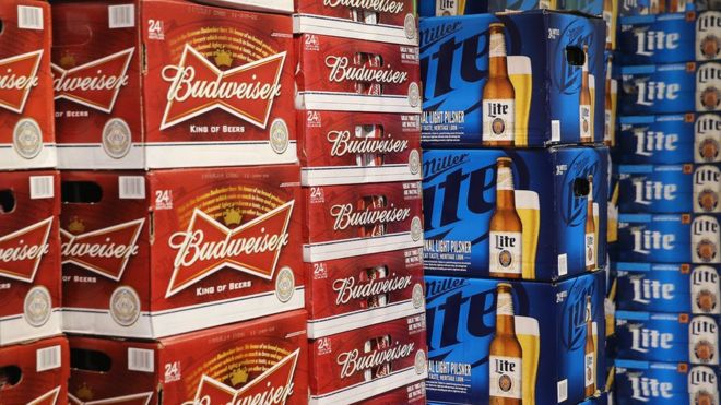 Cases of Budweiser and Miller Lite on display in a Chicago store