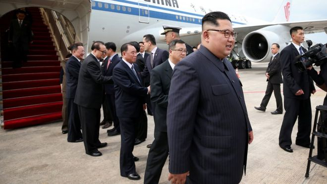 Kim Jong-un walking off his plane in Singapore