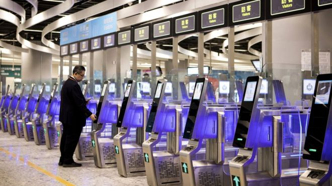 A man uses an immigration clearance machine at the Hong Kong Express Rail Link