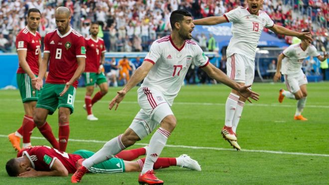 c4954c27804 Iranian players celebrate after Morocco s Aziz Bouhaddouz scores an own  goal in the 2018 World Cup