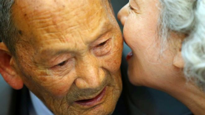South Korean Lee Jeong-Suk, 68, whispers to her North Korean father Ri Heung-Jong, 88, during a separated family reunion meeting at the Mount Kumgang resort on the North's south-eastern coast on October 20, 2015