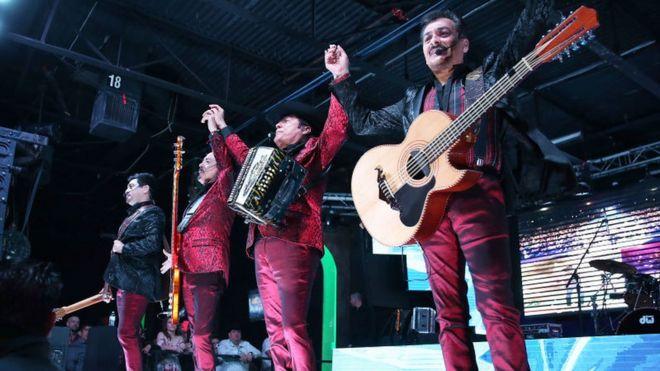 Los Tigres del Norte on stage - four musicians