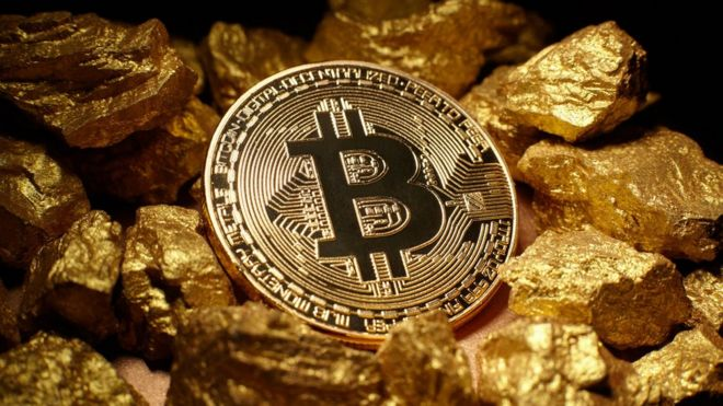 Bitcoin and a pile of gold