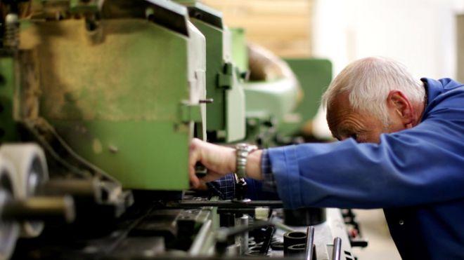 Worker on factory machine