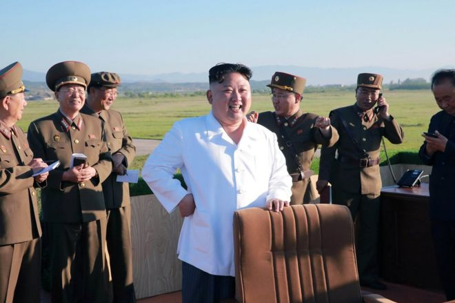North Korean leader Kim Jong-un watches the test of a new-type anti-aircraft guided weapon system organised by the Academy of National Defence Science in this undated photo released by North Korea's Korean Central News Agency