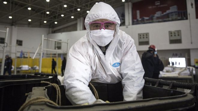 A worker wears a protective mask while cleaning construction waste at WuhanKeting on February 4th.2020 in Wuhan.Hubei Province,China.