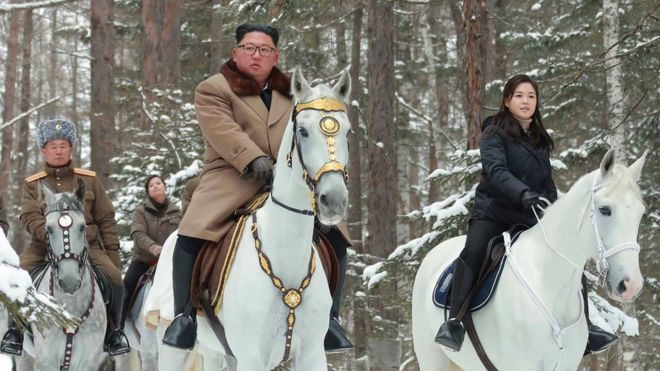 An undated picture released by North Korea's official Korean Central News Agency (KCNA) on 4 December, 2019 shows North Korean leader Kim Jong-un (C) riding a horse as he visits battle sites at Mount Paektu, Ryanggang