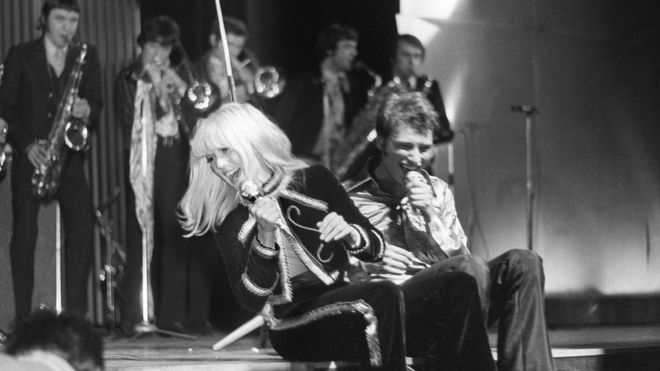 A file photograph taken on March 17, 1967 in Paris, shows Sylvie Vartan (L) and Johnny Hallyday singing as they give a concert, the profits of which are to go to cancer research, at the Olympia venue