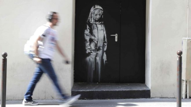 An artwork by street artist Banksy in Paris, on a side street to the Bataclan concert hall