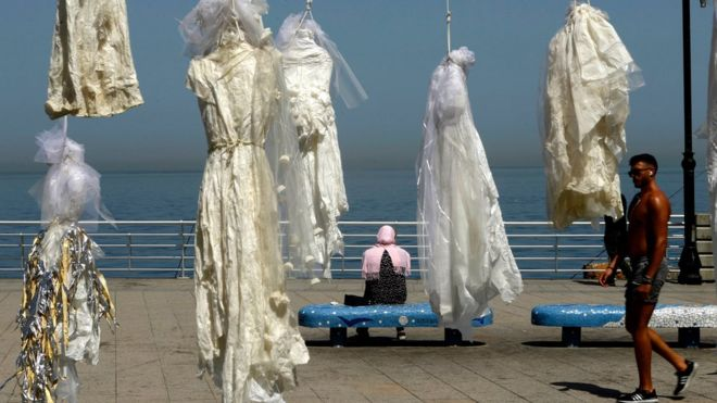 Wedding dresses hung on the Beirut sea front
