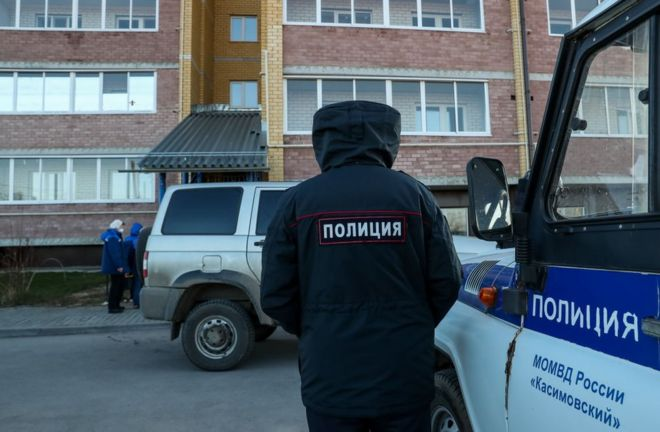 A policeman at the scene of the shooting in the village of Yelatma, Russia