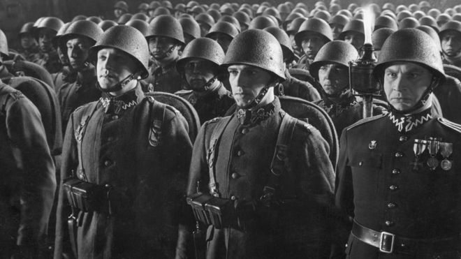 circa 1939: A Polish infantry regiment standing to attention during a parade at night. (Photo by Fox Photos/Getty Images)