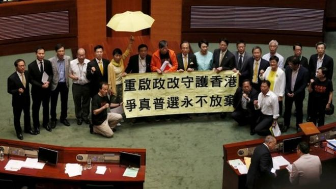 Pro-democracy lawmakers chant slogans after voting at Legislative Council in Hong Kong, China June 18, 2015.