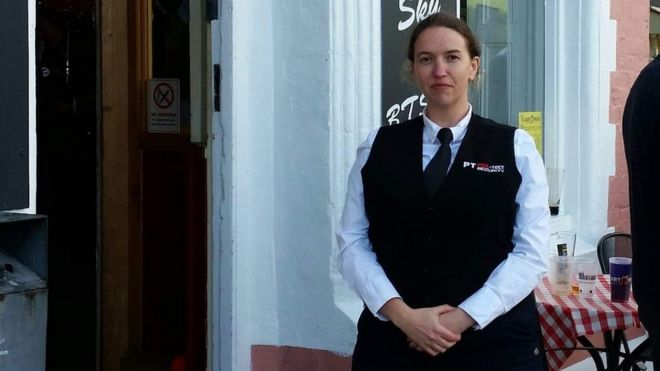 Woman wearing security uniform