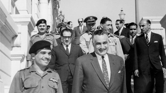 King Hussein of Jordan (1935 - 1999) (l) and Egyptian President Gamal Abdul Nasser (1918 - 1970) smile after signing a Jordan-Egyptian defence agreement June 1967 in Cairo.