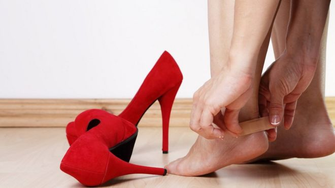 c6f2cb09fb24db Woman applying an adhesive bandage on a wound on her heel Image copyright  Getty Images Image caption Finding women s shoes ...