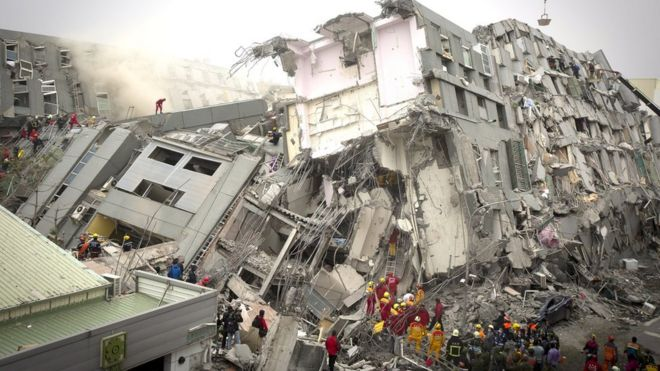 Rescue personnel search for survivors at the site of a collapsed building on February 6, 2016 in Tainan, Taiwan. A magnitude 6.4 earthquake hit southern Taiwan