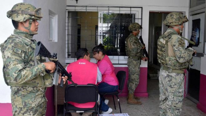 Members of the Mexican Navy stand guard next to electoral material, on June 30, 2018, in Acapulco