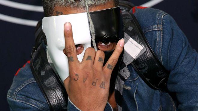 XXXTentacion wearing a half black, half white mask