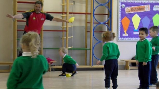 Primary school pupils doing PE