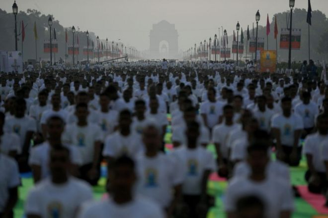 Indian yoga practitioners participate in a mass yoga session on International Yoga Day in New Delhi on June 21, 2019.