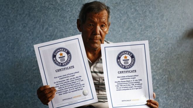 Ang Rita Sherpa holds his Guinness World Records certificates