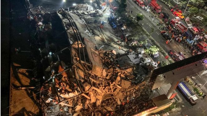 Rescuers search for survivors in the rubble of a collapsed hotel in Quanzhou, in China's eastern Fujian province on 7 March 2020.