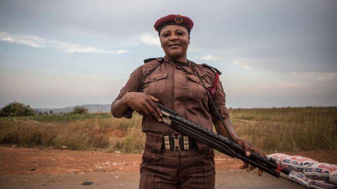 Vigilante Group of Nigeria, Barkin Ladi Division member Sarah Dung, 39, guards a check point in Barkin Ladi, Nigeria on Wednesday, October 24, 2018.
