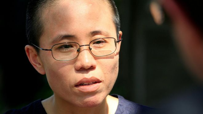 Liu Xia, wife of veteran Chinese pro-democracy activist Liu Xiaobo, listens to a question during an interview in Beijing, China June 24, 2009.
