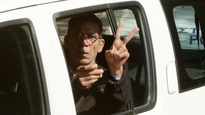 Seif al-Din Mustafa giving a V-sign as he is driven away after the hijacking, March 2016