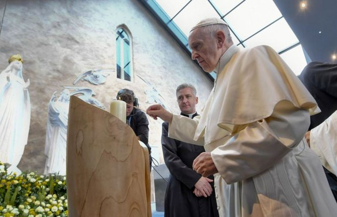 Pope Francis lights a candle at the Knock shrine