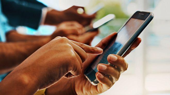 Men using mobile phones