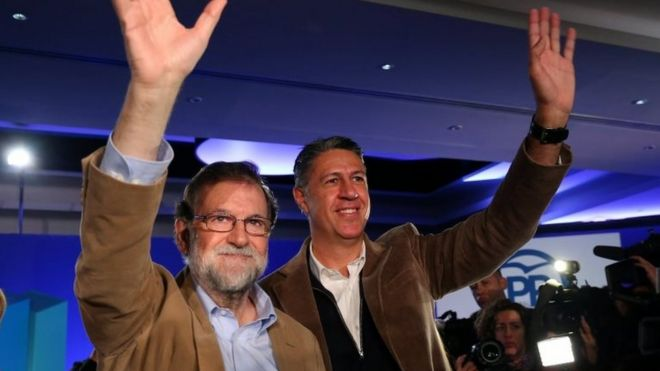 """Spanish Prime Minister Mariano Rajoy and Catalan People's Party (PP) president Xavier Garcia Albiol wave as they arrive at a Catalan regional People""""s Party meeting in Barcelona, Spain 12 November 2017"""