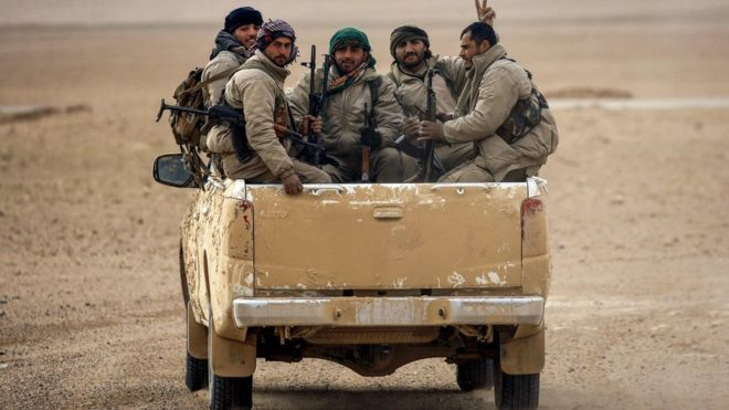 File photo shows members of the Syrian Democratic Forces (SDF) in vehicle north of Raqqa (8 February 2017)