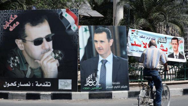 لافتات انتخابية مؤيدة لبشار الأسد تغطي شوارع دمشق