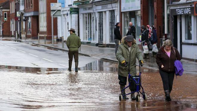wade through flood water in Tenbury Wells, Worcestershire